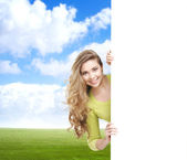 Teenage girl with a blank banner — Stock Photo