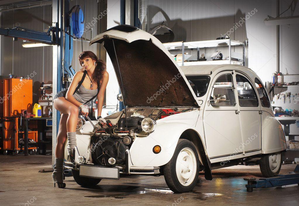 Woman repairing the retro car stock editorial photo for Garage auto st genest lerpt