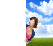 Girl with the blank banner. Perfect space to put any text. — Stock Photo