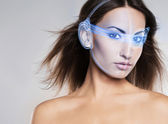 Woman with the laser hologram on her eyes — Stock Photo