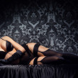 Постер, плакат: Young and sexy woman posing in erotic lingerie