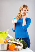 Housewife woman cooking in kitchen — Stock Photo