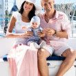 Young family on sailing boat — Stock Photo #48691257