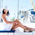 Beautiful woman on luxury yacht — Stock Photo #48691457