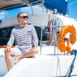 Handsome man on sailing boat — Stock Photo #48691643