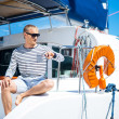 Handsome man on sailing boat — Stock Photo #48691663