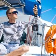 Handsome man on sailing boat — Stock Photo #48691707
