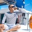 Handsome man on sailing boat — Stock Photo #48691779
