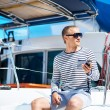 Handsome man on sailing boat — Stock Photo #48691841