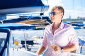 Handsome man on a luxury yacht — Stock Photo