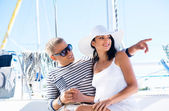 Attractive couple on sailing boat — Stockfoto
