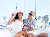 Attractive couple on sailing boat — Stok fotoğraf