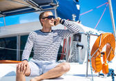 Handsome man on sailing boat — Stock Photo