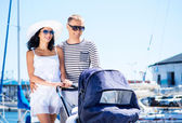 Couple walking with baby pram — Stock Photo