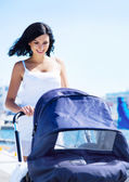 Mother with baby pram — Stock Photo