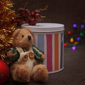 Christmas arrangement with a teddy bear and gifts — Stock Photo