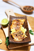 Fried white fish, served with lime and parsley — Stock Photo