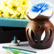 Aromatherapy set with flower candle and incense — Stock Photo #19480359