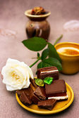 Romantic breakfast with white rose and chocolate — Stock Photo