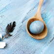 Stock Photo: Easter still life with blue egg and feather