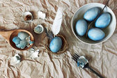 Still life with blue easter eggs with cutlery — Foto Stock