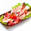 Fresh bacon stripes served with greens and tomato. On white back — Stock Photo #45132805