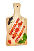 Bacon stripes, sun-dried tomatoes, fresh basil leaves served on  — Stock Photo