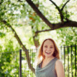 Beautiful laughing young woman in the park. Summer, wind. Freedo — Stock Photo #45428513