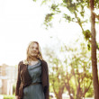 Beautiful young woman walking in the city park. Summer, wind. Fr — Stock Photo #45428463