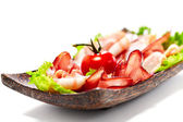 Bacon stripes served with greens and tomato. Isolated on white b — Stock Photo