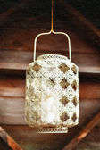 Old-fashioned lacy white lantern. Textured background. — Stock Photo