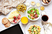 Fresh continental breakfast. Healthy food. Tablet, black screen. — Stock Photo