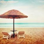 Tropical beach view. Two beach chairs. — Stock Photo #48542763