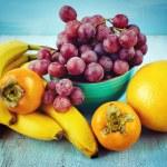 Fresh fruits on blue background — Stock Photo #49580311