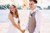 Happy wedding couple laughing — Stock Photo