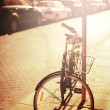 Bicycle resting at the street — Stock Photo