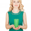 The beautiful blonde holds a green glass — Stock Photo #28141571