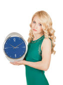 Unhappy young woman with horror looks at an clock on a white background. — Stock Photo
