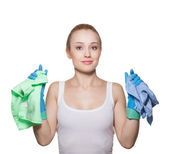 The beautiful blonde in gloves and rags for cleaning — Stock Photo