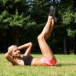 The beautiful blonde stretching outdoors — ストック写真