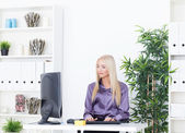 Young beautiful business woman working with computer — Stock Photo