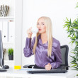 Stock Photo: Cheerful female having coffee break in office