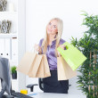 The young woman at office with beautiful bags — Stock Photo