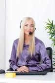 Beautiful blonde, female customer service operator using headset — Stock Photo