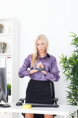 Beautiful blonde in the Office hand tied wire UTP — Stock Photo