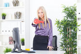 The young woman at office holds big a red key — Stock Photo