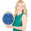 Happy young woman with horror looks at an clock on a white background. — Photo