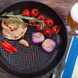 Meat, beer and vegetables in frying pan — Stock Photo