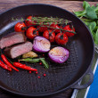 Meat and vegetables in frying pan — Stock Photo