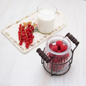 Currant raspberry vintage ware on a wooden board — Stock Photo